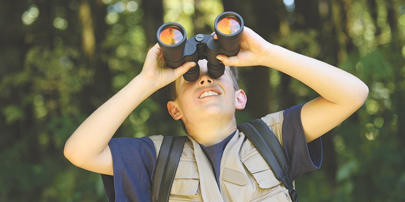 summer camp. 4 benefits of summer camp for school aged children. summer camp montgomery al. Montgomery summer camps. Alabama summer camps. boy looking through binoculars.