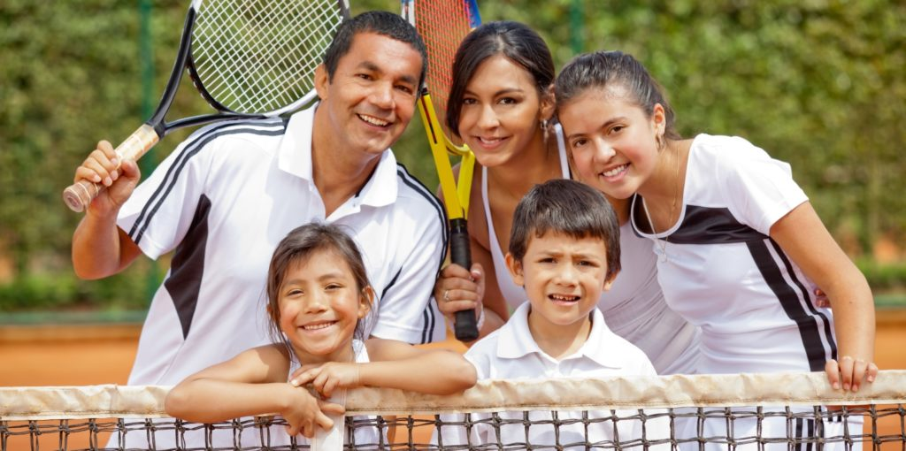 Happy family playing tennis and holding rackets. Tennis Lessons. Tennis Lessons Montgomery. Adult Tennis Lessons. Kids Tennis Lessons.