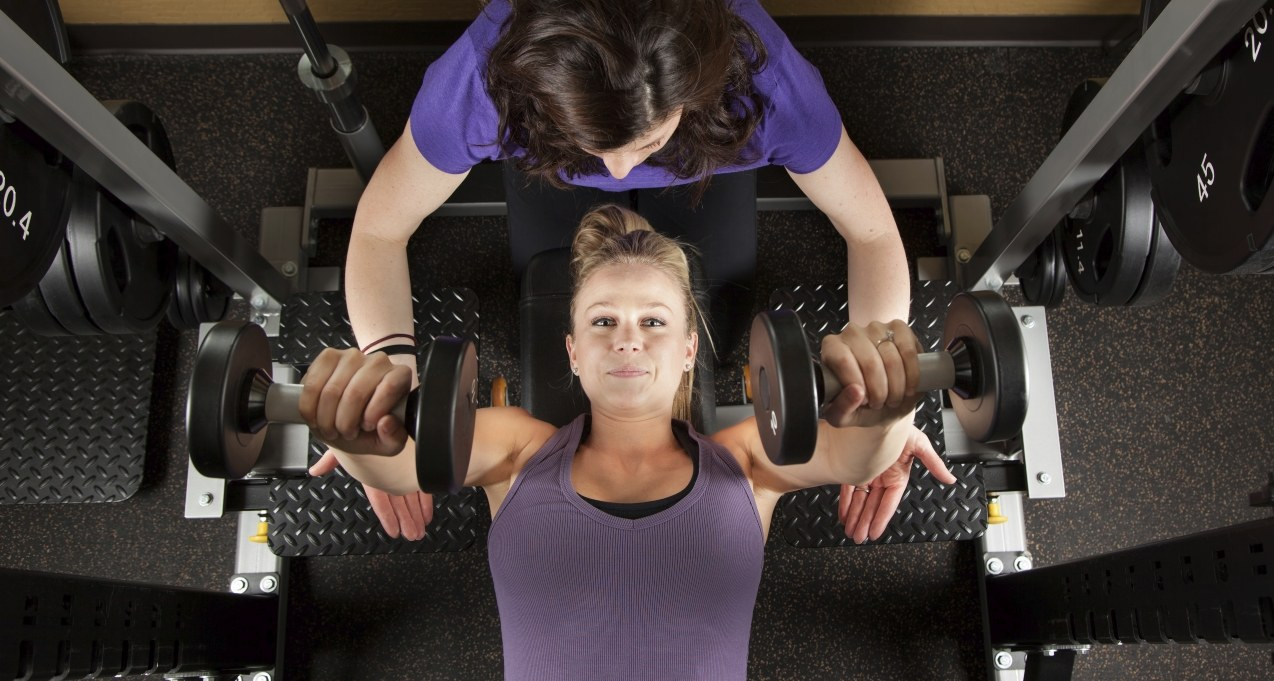 Lady working out with a personal trainer during a Personal Training session
