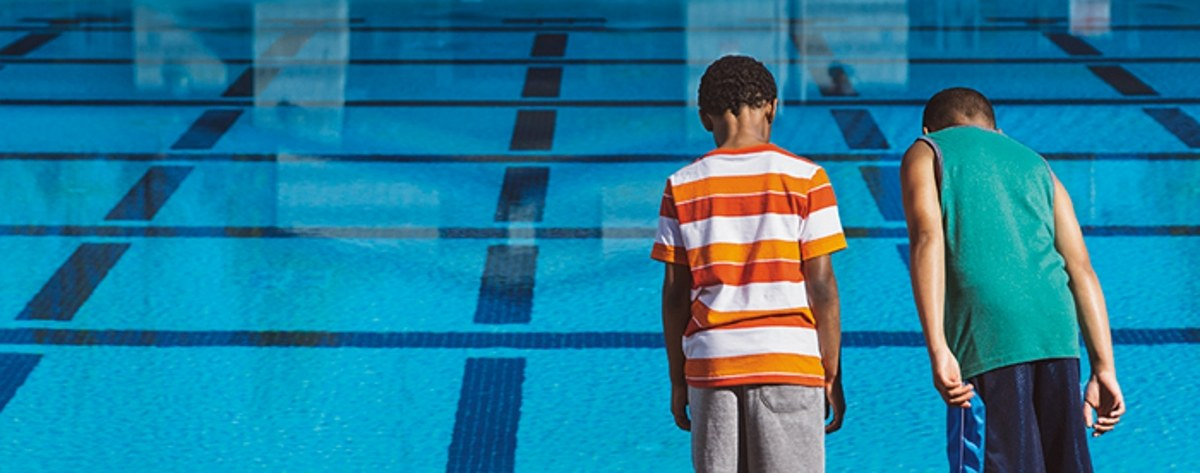 safety around water. Swimming Lessons Montgomery AL. Two Boys staring at a pool.
