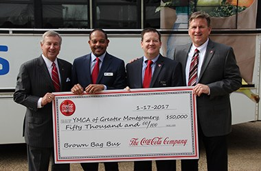 YMCA of Greater Montgomery and Coca Cola Team Up To Help End Hunger. Men from Cocoa-Cola and The YMCA of Greater Montgomery hold a check for $50,000