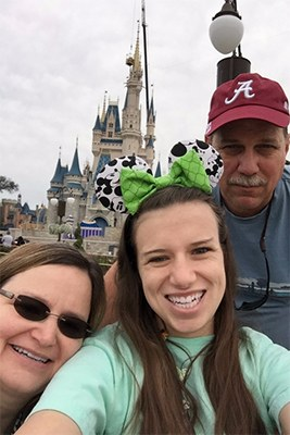 YMCA Provides Magic Moment. Carrie Mason. Camp Chandler. Carrie Mason and her family at Disney World.