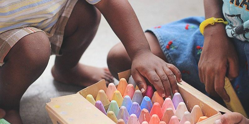 Alabamas First Class Pre-k program. Montgomery AL. Montgomery AL Preschool. image of kids playing with sidewalk chalk