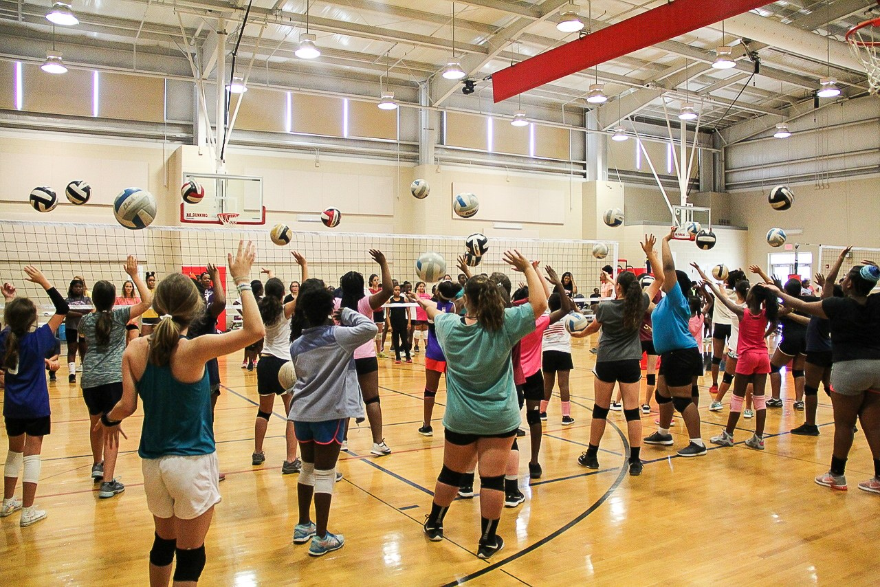 girls spiking and blocking volleyball. Youth Volleyball. Youth Volleyball league. Youth volleyball leagues montgomery.