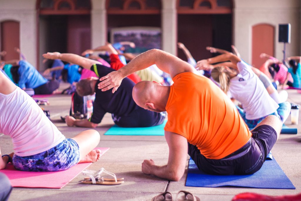 Group exercise. Yoga. Join the Y. Pay the Day.